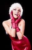 作为圣诞老人打扮的妇女 免版税库存照片