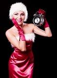 作为圣诞老人打扮的妇女 库存照片