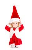 作为圣诞老人打扮的小女孩 库存照片