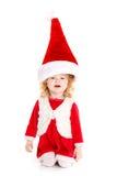 作为圣诞老人打扮的小女孩 图库摄影