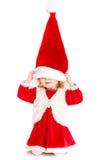 作为圣诞老人打扮的小女孩 免版税库存照片