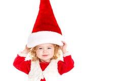 作为圣诞老人打扮的小女孩 库存图片