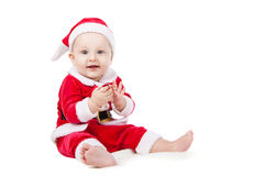 作为圣诞老人打扮的小的子项 库存图片