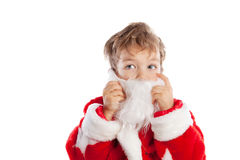 作为圣诞老人打扮的小的男孩,隔离 免版税库存图片