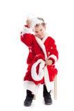 作为圣诞老人打扮的小的男孩,隔离 库存图片