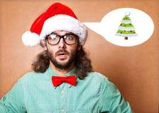 作为圣诞老人打扮的英俊的人 库存照片