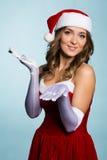 作为圣诞老人打扮的迷人的女孩 库存照片