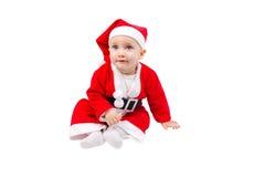 作为圣诞老人打扮的逗人喜爱的孩子 图库摄影