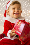 作为圣诞老人打扮的婴孩 库存照片