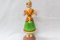作为在泰米尔人语言的Thalaiyatti叫的坦贾武尔跳舞玩偶的面孔Bommai与极为相象的传统礼服和oranments 免版税库存照片