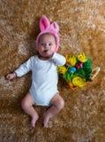 作为复活节兔子打扮的婴孩 免版税库存图片