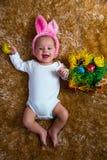 作为复活节兔子打扮的婴孩 免版税库存照片