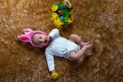 作为复活节兔子打扮的婴孩 图库摄影