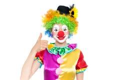 作为小丑的美丽的少妇 免版税库存图片