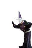 作为巫术师打扮的人,隔绝在白色背景 免版税库存照片