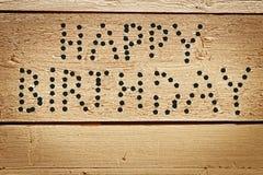 作为弹孔文本被做的生日快乐祝贺  免版税库存照片