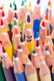 作为微笑的面孔的五颜六色的铅笔 库存图片