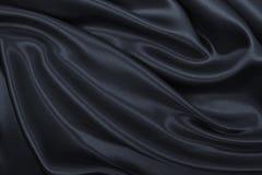 作为抽象backg的光滑的典雅的深灰丝绸或缎纹理 免版税库存照片
