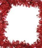 作为框架的圣诞节红色闪亮金属片。 库存照片