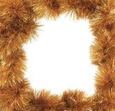 作为框架的圣诞节金黄闪亮金属片。 库存照片
