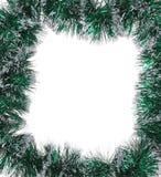 作为框架的圣诞节绿色闪亮金属片。 库存图片