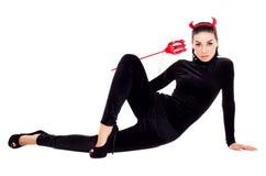 作为淘气鬼打扮的妇女 免版税库存照片