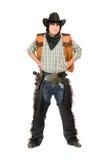 作为牛仔打扮的年轻人 免版税库存照片