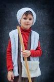 作为牧羊人打扮的男孩 库存图片