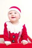 作为男婴克劳斯穿戴的圣诞老人 免版税库存图片