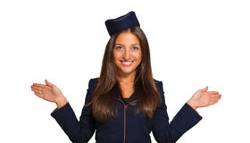 作为空中小姐打扮的一个美丽的少妇的画象 图库摄影
