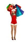 作为穿戴的圣诞老人妇女年轻人 库存图片