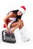 作为穿戴的女孩打印圣诞老人打字机 免版税库存图片