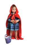 作为穿戴的女孩敞篷少许红色骑马 库存照片