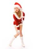 作为美丽的加工好的女孩圣诞老人 免版税库存照片