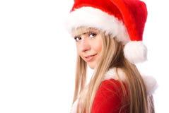 作为美丽的穿戴的女孩纵向圣诞老人 库存图片