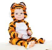 作为老虎打扮的婴孩 库存图片