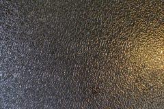 作为背景灰色金子的毛玻璃纹理 库存照片
