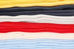 作为背景的各种各样的五颜六色的织品 库存图片