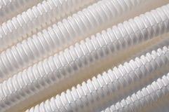 作为背景的塑料波纹状的管子 免版税库存图片