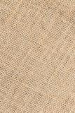 作为背景的大袋织地不很细棕色帆布织品 免版税图库摄影