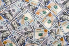 100作为背景的新的美元钞票 免版税库存图片