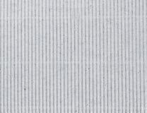 作为背景的波纹状的灰色纸板 免版税库存照片