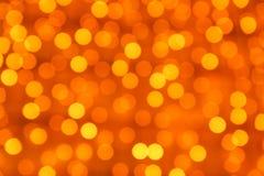 作为背景的被弄脏的橙色光 免版税库存照片