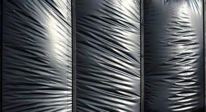 作为背景的黑胀大的聚乙烯箔 库存照片