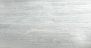 作为背景,木木条地板的浅褐色的软的木地板表面纹理 老难看的东西洗涤了橡木层压制品的样式顶视图 免版税库存图片