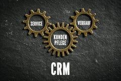 作为被连接的钝齿轮被象征的客户关系管理组分 免版税库存照片