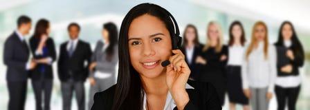 作为覆盖客户友好帮助有用的爱服务微笑对非常您的美丽的女实业家的天使 库存图片