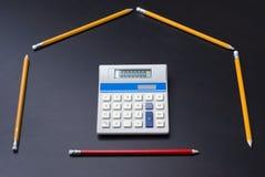 作为计算器门房子铅笔 免版税库存图片