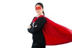作为超级英雄打扮的友好的女实业家 库存图片