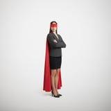 作为超级英雄打扮的女实业家 图库摄影